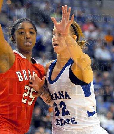 Positions: Bradley defender Latasha Hollingshed (25) tries to keep Andrea Rademacher(32) out of the paint.