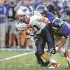 Tribune-Star/Joseph C. Garza<br /> Hard to handle: Terre Haute North's Daniel Gabbard breaks free from two Ben Davis defenders during the Patriots' road game against the Giants Friday, Sept. 17 in Indianapolis.