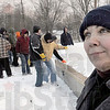 Warm feeling on a cold day: Despite cold temperatures Jennifer Clark displays her happiness as a large group of volunteers prepare the site for the start of construction Saturday morning.