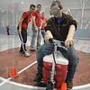 Help!: Honey Creek Student Michael Beckner tries to navigate thru the cones wearing drunk goggles as Rose-Hulman students help in the background.