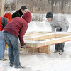 Heavy: Rose-Hulman student volunteers carry pre-fab panels for the start of a Habitat build located at 2230 Chase Street Saturday morning.