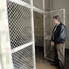 Cell: Bryan Duncan, director of capital planning for Indiana State University peers into a jail cell located in the former Federal Building at 7th and Cherry.