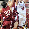 Tribune-Star/Jim Avelis<br /> Inside man: Jon Gerken(41) shoots from in close past Pioneer defender Chris Owens(20).