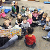 Day care activities: Barbara Davis reads a book to kids in the Maple Avenue Methodist Church Day Care Thursday morning.