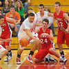 On the loose: Braves Anthony McGill, left and Jeffrey Turner(40) scramble for a loose ball with Star Logan Bailey(23).