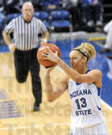 Three: Deja Mattox launches a three-point-shot and scores during first half action at Hulman Center.
