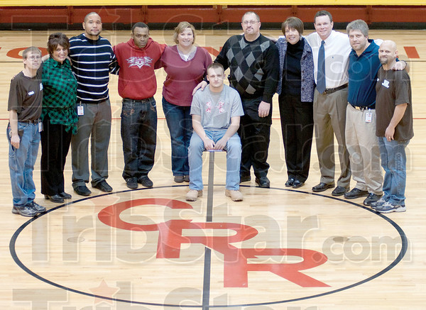 Dream Team: Chancey Rose Student Daniel Walls pictured with the team of first responders who came to his aid after a near death cardiac arrest. (left to right) Chris Poff, Connie Mallory-Johnson, Richard Moother, Chris Howard, Felicia Walls, Daniel Walls, Dan Walls, Meg Merrill, Greg Gauer, Doug Stage, Wayne Noel