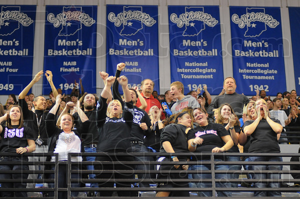 Woo hoo: Sycamore fans cheer as the refs call Jake Kelly's shot good. Kelly went on to win the game.