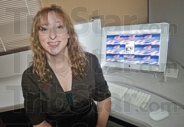 "Men of Honor: Sue Drapper sits in front of her website  <a href=""http://www.honorourindianaveterans.com"">http://www.honorourindianaveterans.com</a>. The website was founded to support local troops."