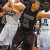 Defense: R.J. Mahurin gets tangled up under the basket with Missouri State's Kyle Weems(34).