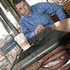 Coffee and a Book: Stephen Marchese sit at Starbucks with his E-reader.