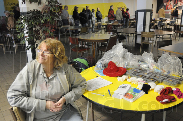 Counting: Reba Luken spent her afternoon at the Lighthouse Mission getting an accurate count of homeless Wednesday afternoon. The homeless wait for the serving of lunch.