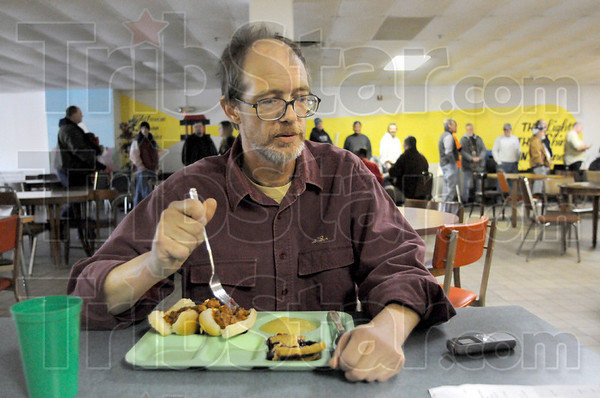 "Homeless: A man identifying himself only as ""Ed"" has lunch at the Lighthouse Mission Wednesday."