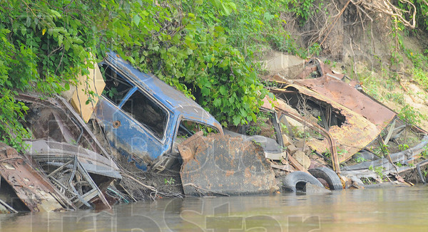 Erosion control: Junk cars, used to prevent bank erosion, line the bank of the Wabash River north of Terre Haute.