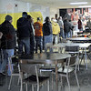 Lunch line: Scores of homeless line up at the Lighthouse Mission for lunch Wednesday afternoon.