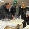Informational meeting: Eddy Adams of the Natural Resources Conservation Service talks with landowners Bruce Clark and his mother Opal.