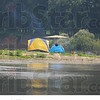 Leisure time:  A tent, grill and tiki torches make for a vacation atmosphere on a sandbar on the Wabash River this past August.