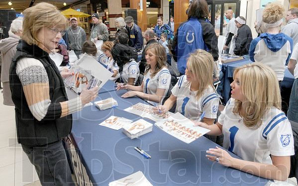 Thanks: Sheila Crapo (L) talks with several Indianapolis Colts cheerleaders at Honey Creek Square Wednesday morning.