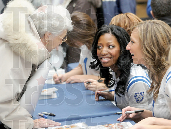 Glad to see ya:  Colts fan Gladys Phillips stops to chat with several Colts cheerleaders as she shops at Honey Creek Square Wednesday morning.