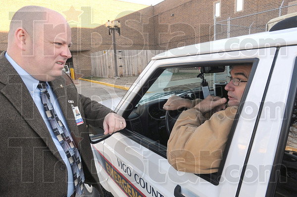 Planning: Sheriff Greg Ewing and reserve deputy J.D. Kesler speak briefly behind the Vigo County Jail Wednesday afternoon as they coordinate a meeting later in the week.