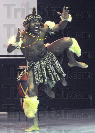 Dancer: Jomo Xulu performs as the lead dancer for the Umdabu South African Dance Theater Monday afternoon during the Youth Summit at the Booker T. Washington Center.