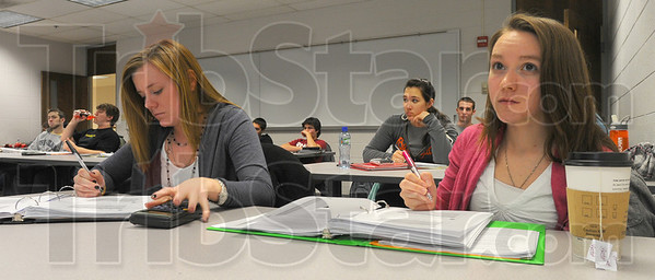 In session: Brittany Lake of Petersburg and Betsy Jones of Brownsburg take notes in their Math class at Rose-Hulman. Admissions figures for the 2011-2012 school year show 4,000 application for incoming freshmen with a record 23 percent of them being women.