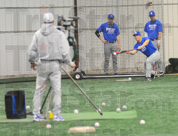 Tap: Indiana State's Levi Ferguson lays down a bunt during baseball practice in the team's indoor facility Friday afternoon.