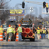 Lights out: State Highway crews install barricades and cover the traffic lights at Third and Vorhees Streets Monday as they prepare to start work on the railroad crossing near the intersection.