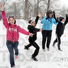 Cheers: North High School seniors Meghan Carney, Caroline Nichols, Rachel Helt and Lauren Isaacs cheer for the players during Tuesday's Snow Bowl game at Collett Park.