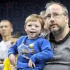 Fan: Sam Alderton of Terre Haute sits on is father Andy's lap during the start of action at Hulman Center Tuesday night.