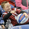 Point: Seven-year-old Jaisen Paulley watches the Harlem Globetrotters at Hulman Center Tuesday night.