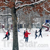 """Snow ball: Several North High School students take advantage of the """"snow day"""" from school and enjoy a game of football at Collett Park."""