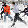 Pursuit: A group of North High School students enjoy a game of football in Collett Park Tuesday afternoon.