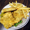 Sandwich: Detail photo of fish sandwich with fries served at Mel's Diner Tuesday afternoon.