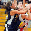 Personal not intentional: Pioneer Mandy Fisher blocks a shot by Terre Haute South center Hannah Lee and commits a foul in the process.