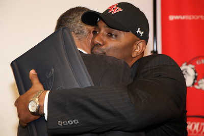 Ron Dickerson, Jr. hugs his father after he was named Gardner-Webb Head Football Coach on January 26, 2010.