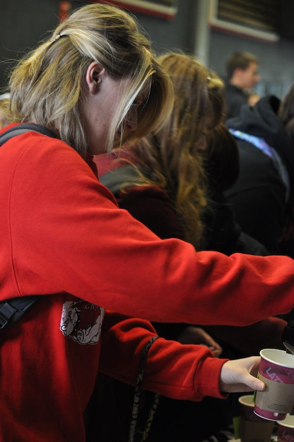 CMU members give out coffee to students in the LYCC concourse on their way into dimensions Tuesday January 24, 2012 .