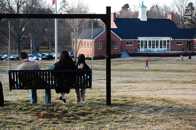 Jacob Keller and family sit and enjoy the beautiful quad on a chilly afternoon.