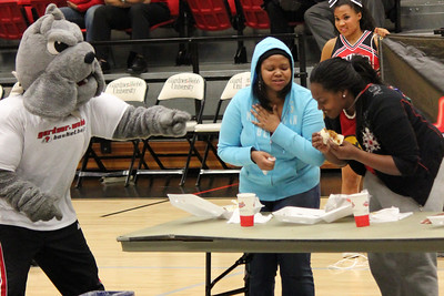 Mac the Bulldog encouarges participants to finish their burritos in a contest during the women's basketball game against Liberty.