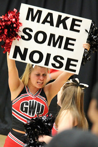 Kaitlyn Prewitt encourages the crowd to make some noise at the women's basketball game.