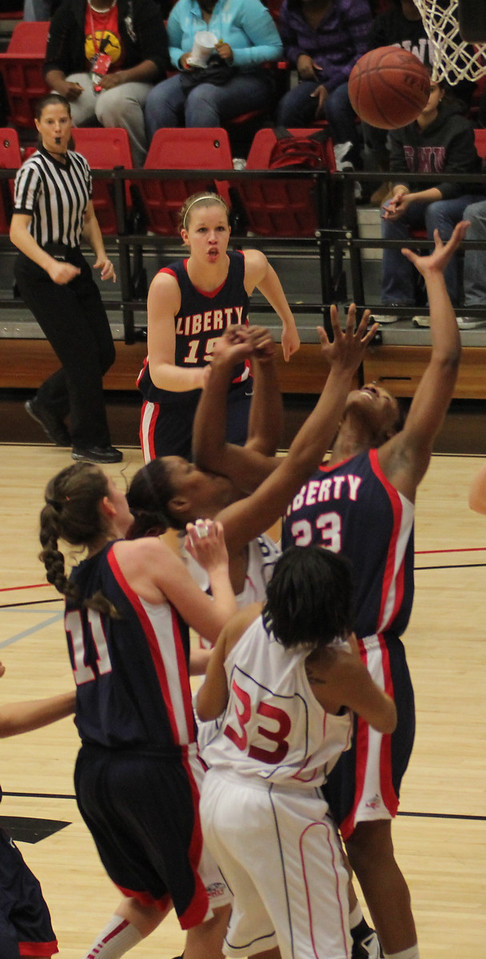 Jasmine Dale (33) and the Flames players go for a rebound in their matchup on January 31st.