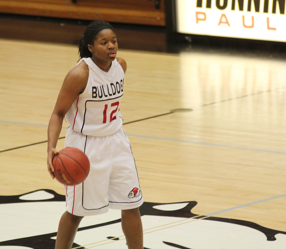 Dominique Hudson (12) brings the ball up the court for the Lady Dawgs.