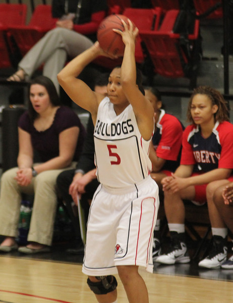 Brianna Dillard (5) looks to pass the basketball in the matchup versus Liberty on the 31st.