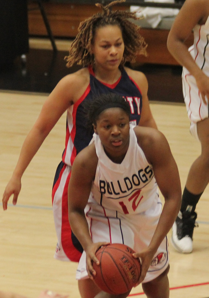 Dominique Hudson (12) gets a rebound in the Lady Dawgs match versus Liberty.