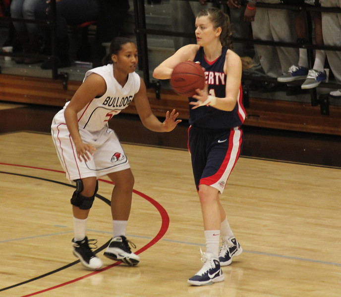Brianna Dillard (5) defends against a Liberty player on Monday January 31st, 2011.