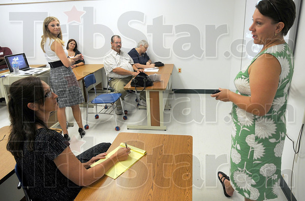 Tribune-Star/Jim Avelis<br /> Welcome: Amy McClain, on the right, greets a small crowd attending a meeting presented by Marissa Lynch of School Choice Indiana. McClain, principal at St. Pat's School hosted the meeting.