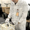 Tribune-Star/Jim Avelis<br /> Processing: Tim Thomas processes the paper work on a donated pint of blood just after it has been given.
