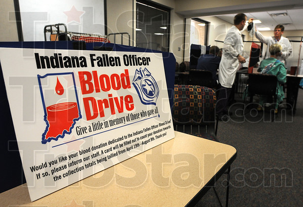 Tribune-Star/Jim Avelis<br /> Good cause: A sign in the blood donation room at Regional Hospital tells donors the reason for the effort.