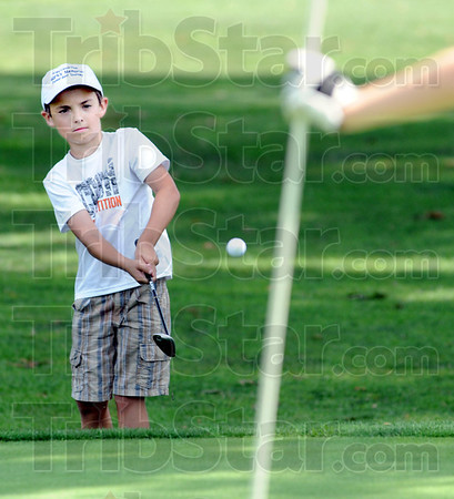 Chip shot: Eight-year-old David Hayes hits a shot to the green during Jr. City Championship action Thursday afternoon.