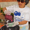 Tribune-Star/Jim Avelis<br /> Got the blues: Rebecca Graves serves up blueberries over ice cream at the Blueberry festival Thursday afternoon. The event was a fundraiser for the Terre Foods Co-operative.